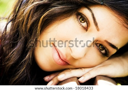 Young beautiful green eyed woman portrait - stock photo