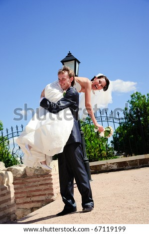 Young beautiful happy married couple outdoors - stock photo