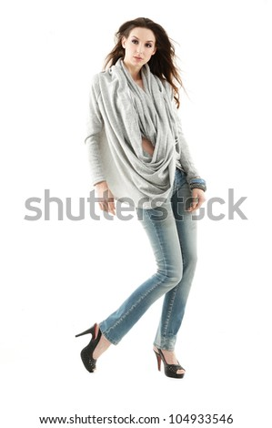 Young beautiful happy smiling fashion woman in casuals - isolated on white background. Full length portrait - stock photo