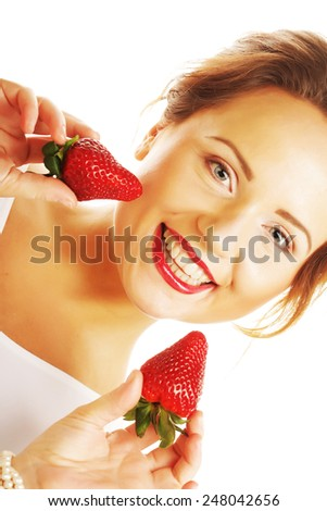 Young beautiful happy smiling woman with strawberry - stock photo