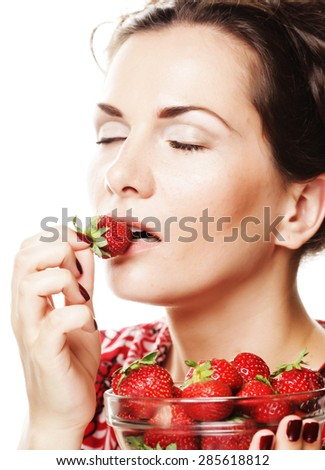 Young beautiful happy smiling woman with strawberry .