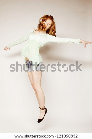 Young beautiful happy woman jumping - stock photo