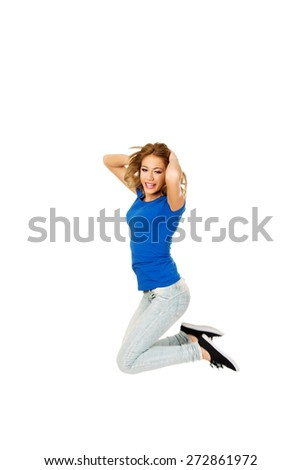 Young beautiful happy woman jumping.