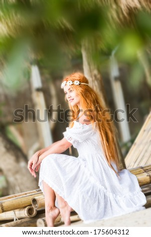 young beautiful happy woman on natural tropical background - stock photo