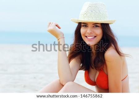 Young beautiful happy woman resting on the beach - stock photo