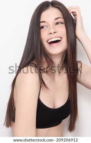 Young beautiful healthy laughing teen girl with long hair - stock photo