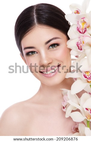 Young beautiful healthy smiling happy woman with white orchid over white background - stock photo
