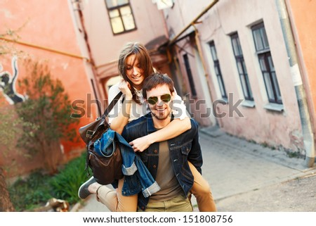 Young beautiful hipster couple having fun outdoor in summer. - stock photo