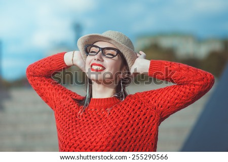 Young beautiful hipster girl in hat and glasses enjoy sunlight outdoor  - stock photo