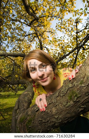 Young beautiful homely woman in park - stock photo