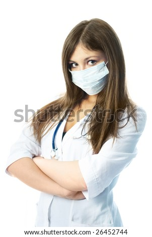 young beautiful hospital worker wearing uniform and a protective mask - stock photo