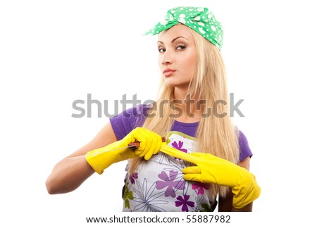 young beautiful housewife in rubber yellow gloves with knife