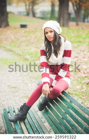 young beautiful indian woman at the park in autumn