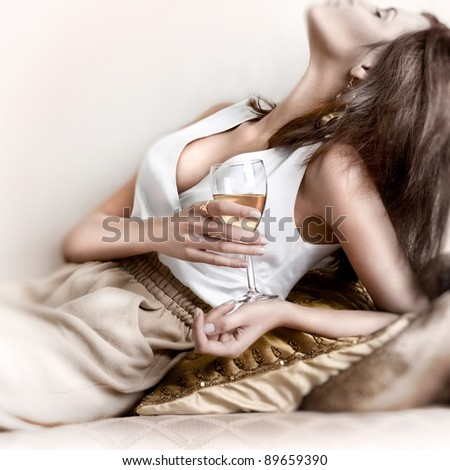 Young beautiful lady drinking champagne. - stock photo