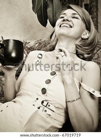 Young beautiful lady drinking coffee - stock photo