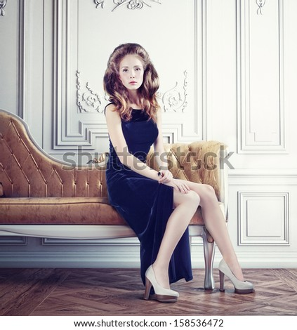young beautiful lady on the vintage sofa