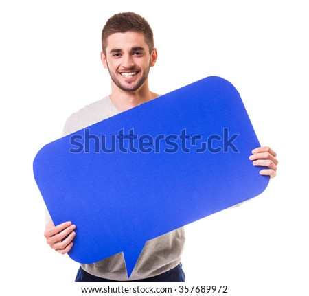 Young beautiful man holding a blue bubble for text, isolated on a white background - stock photo