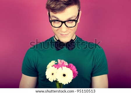 Young beautiful man with flowers - stock photo