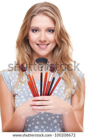 young beautiful model with brushes isolated on white - stock photo