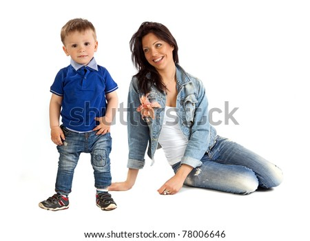 Young beautiful mother and her son spending time together - stock photo