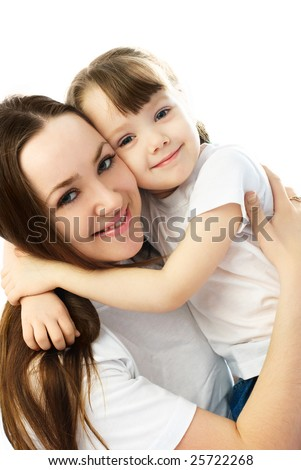 young beautiful mother embracing her little daughter - stock photo