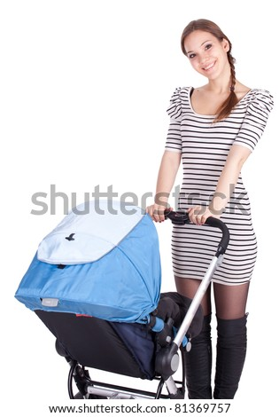 young beautiful mother with baby buggy (stroller) - stock photo