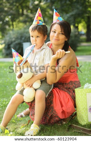 young beautiful mother with son on birthday