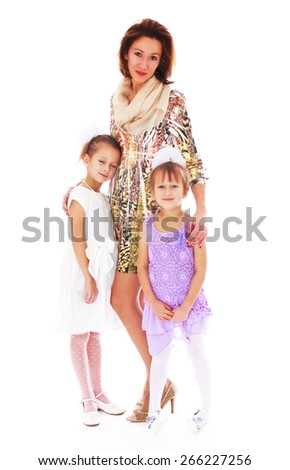 Young beautiful mother with two charming daughters. - isolated on white background - stock photo