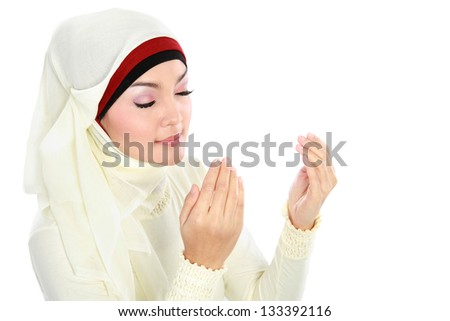 Young beautiful muslim Woman in scarf Praying isolated over white background