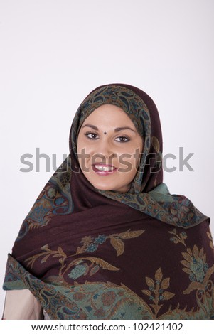 Young beautiful muslim woman with a scarf on her head.