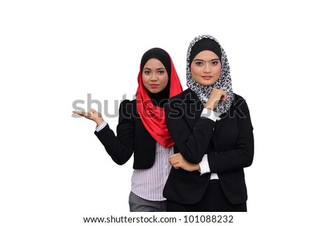 Young beautiful muslim women present in business wear working in office together - stock photo