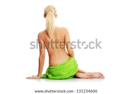 Young beautiful nude blond woman with towel , isolated on white - stock photo