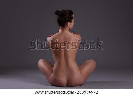 Young beautiful nude woman with towel practicing yoga - stock photo