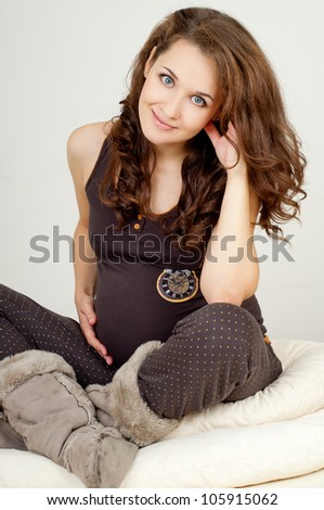 young beautiful pregnant woman in winter clothes - stock photo