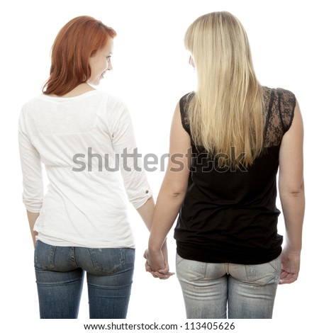young beautiful red and blond haired girls hold hands while you can so the back in front of white background - stock photo