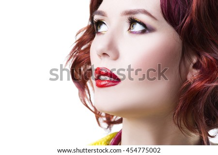 Young beautiful red-haired caucasian woman with professional makeup and hairstyle, isolated on white background, close-up portrait, copy space