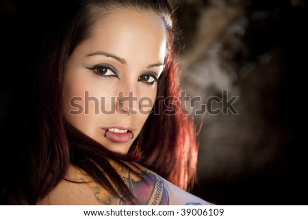 Young beautiful redhair woman portrait staring at camera