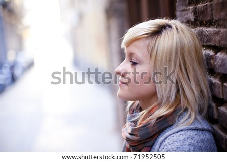 Young beautiful sad girl close portrait - stock photo