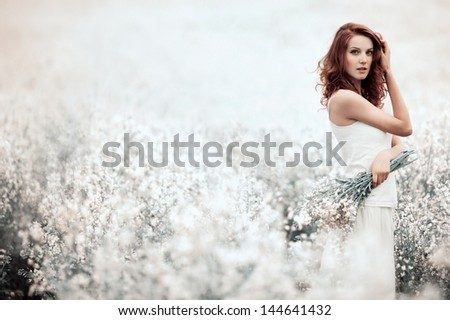 young beautiful sensual girl in the field - stock photo
