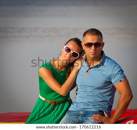 Young beautiful sensual stylish couple in love outdoors. - stock photo