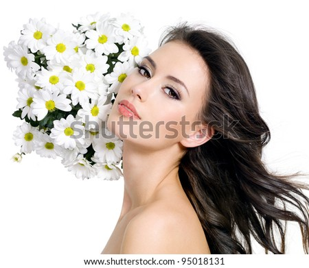 Young beautiful sensual woman with flowers - white background