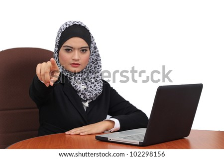 Young beautiful serious muslim business woman pointing on you - stock photo