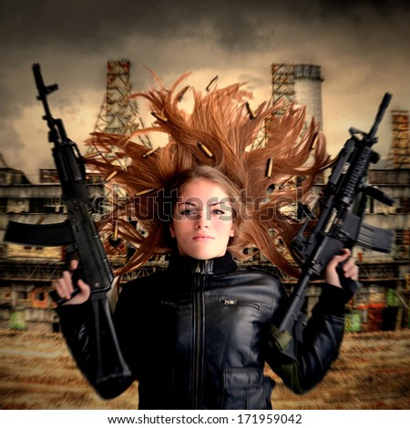 Young beautiful sexy blond Woman holding Handgun in hand - stock photo