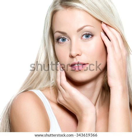 Young beautiful sexy woman touching her fresh face - isolated - stock photo