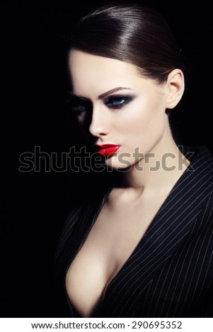 Young beautiful sexy woman with red lipstick and smoky eyes - stock photo