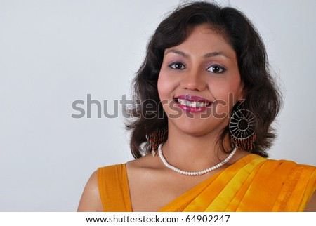 Young beautiful smiling Indian woman for advertising. - stock photo