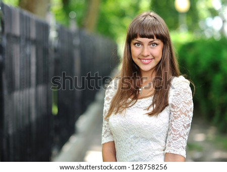 Young beautiful smiling woman face