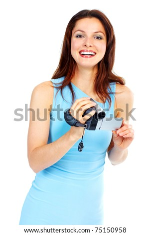 Young beautiful smiling woman holding a photo camera. - stock photo