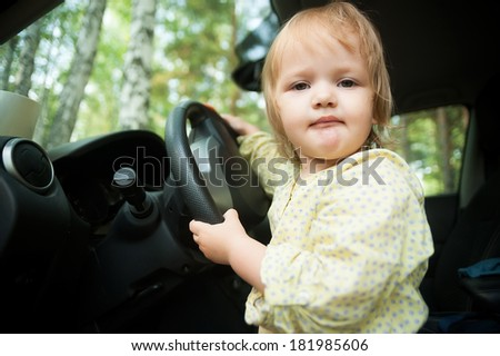 Young beautiful smiling woman sitting in sport car - red interior detail - stock photo