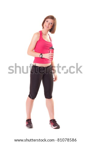 young beautiful sport woman standing with a bottle isolated on white background